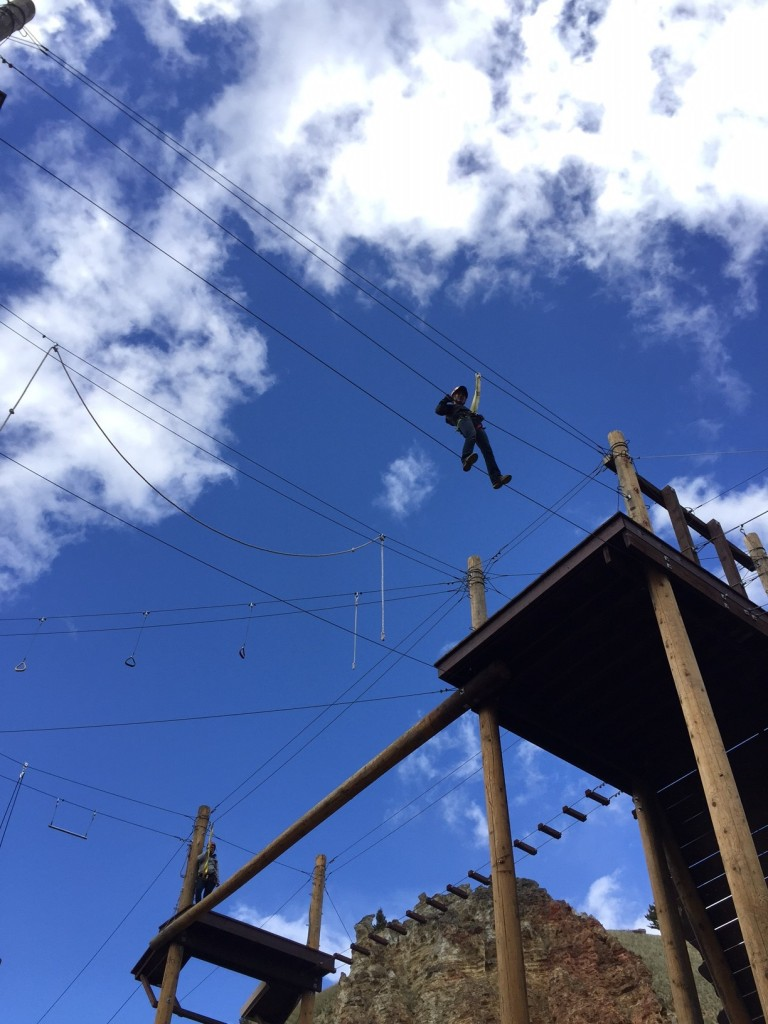 Navigating the ropes course at The Ranch at Rock Creek.