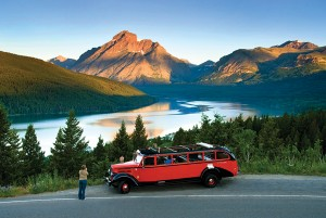 A red bus in Glacier National Park.