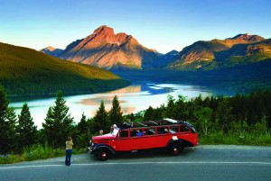 A red bus tour is a popular way to explore Glacier National Park.