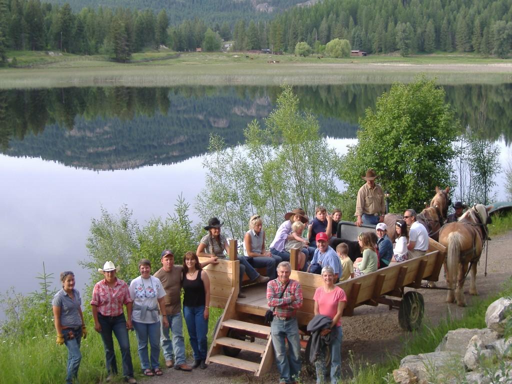 A group enjoys a horse-drawn wagon ride at Bar W Guest Ranch.