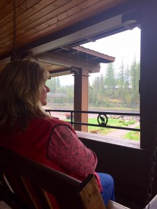 Watching trails roll past from the covered patio of the Izaak Walton Inn.