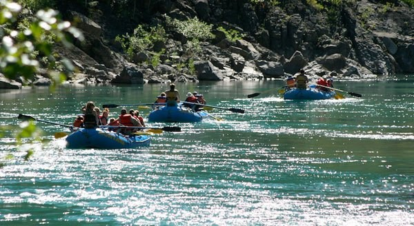 Guided river raft trip. (Photo credit: Glacier Guides, Inc. and Montana Raft Company)