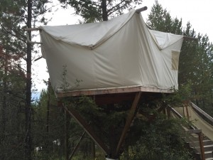 The treehouse at Glacier Under Canvas comes with an attached bathroom.