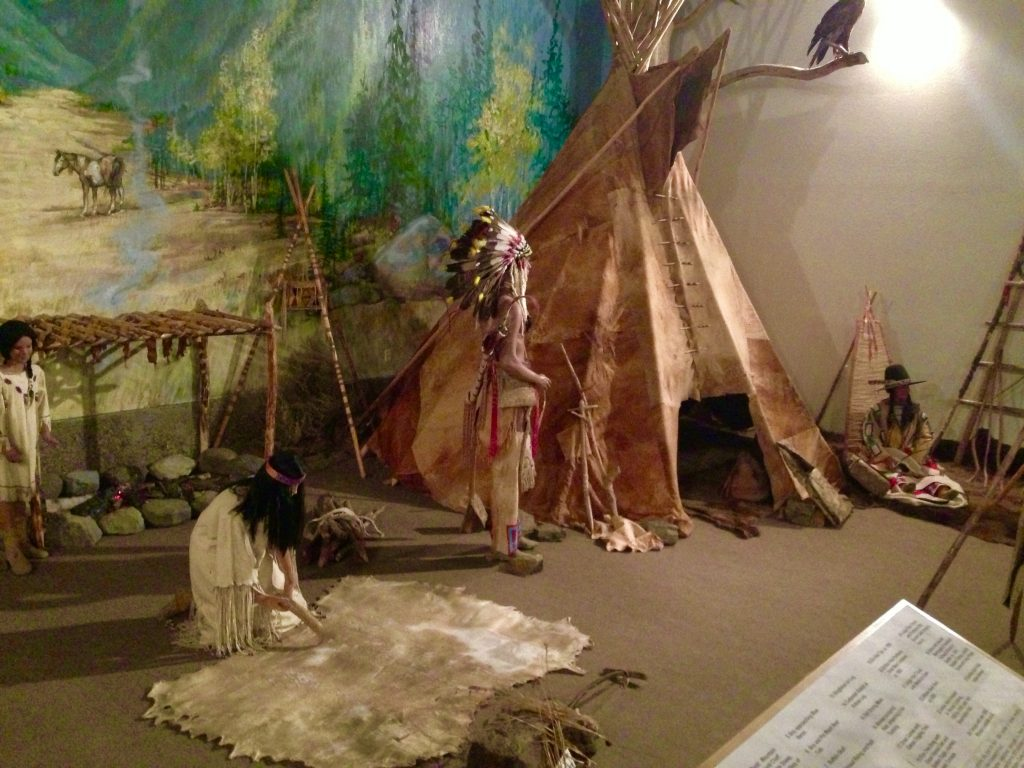 Life-size American Indian encampment display.