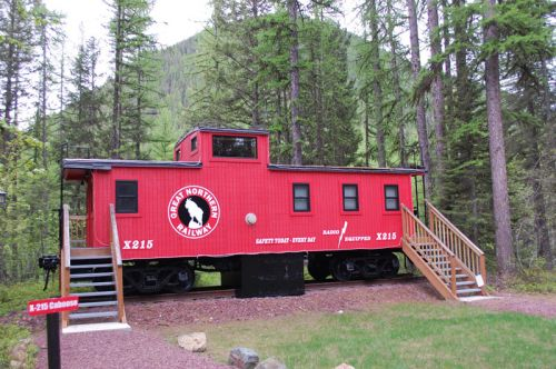 Stay in a caboose. Photo: Izaak Walton Inn