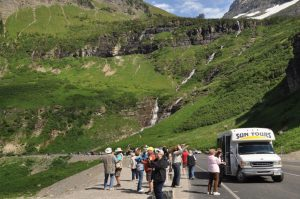 Tour guests take in the views along the Going-to-the-Sun Road.